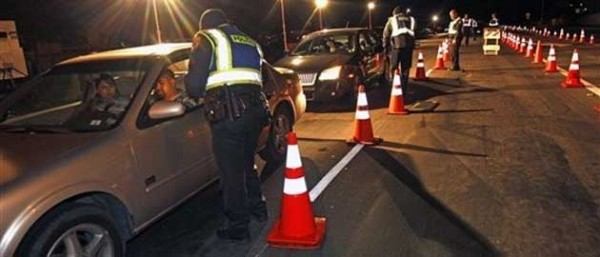 Don't Look Now, But Off Duty Cops in Alabama Are Collecting DNA Swabs at Roadblocks