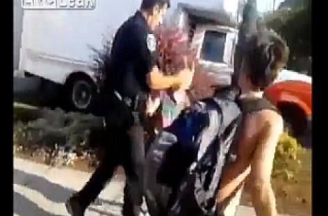 Watch: Why Did This Cop Slap Young Boy in the Face?
