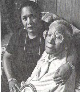 Radiation experiment subject Elmer Allen is comforted by her daughter.