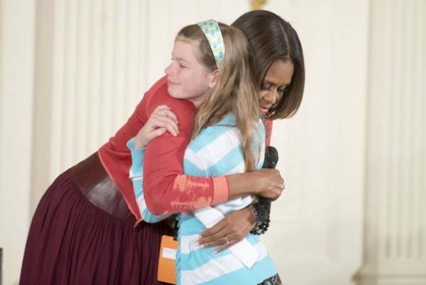 girl hands michelle obama résumé of father who s been unemployed for