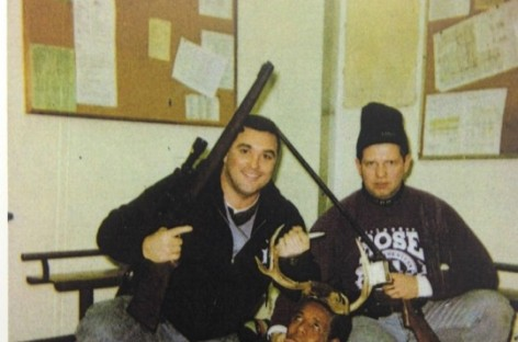 Cop Who Posed With Black Man Dressed in Antlers Wants His Job Back